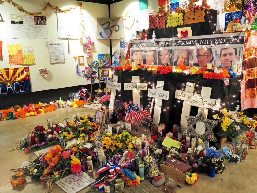 Flowers, teddy bears and inspirational posters line a room at the Arizona History Museum in Tucson in this Wednesday, Jan. 7, 2015 photo. The items were left at the scene of the Jan. 8, 2011 shooting in Tucson that left six dead and 13 wounded. Former Rep. Gabby Giffords was the target and suffered