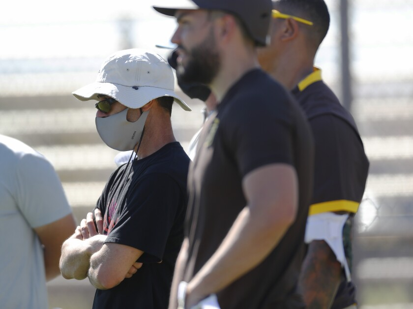 Padres GM A.J. Preller looks on during a spring training practice in Peoria, Ariz.