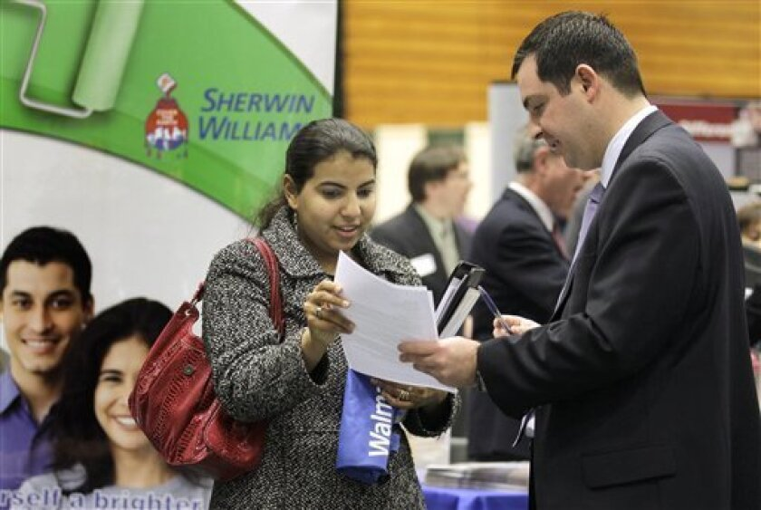 In this March 4, 2011 photo, Heba Mostafa hands her resume to Sean Martin, a representative of Buckeye International, at the 32nd Annual Spring Career Fair at Cleveland State University. The unemployment rate fell to a two-year low of 8.8 percent in March and companies added workers at the fastest two-month pace since before the recession began. (AP Photo/Amy Sancetta)