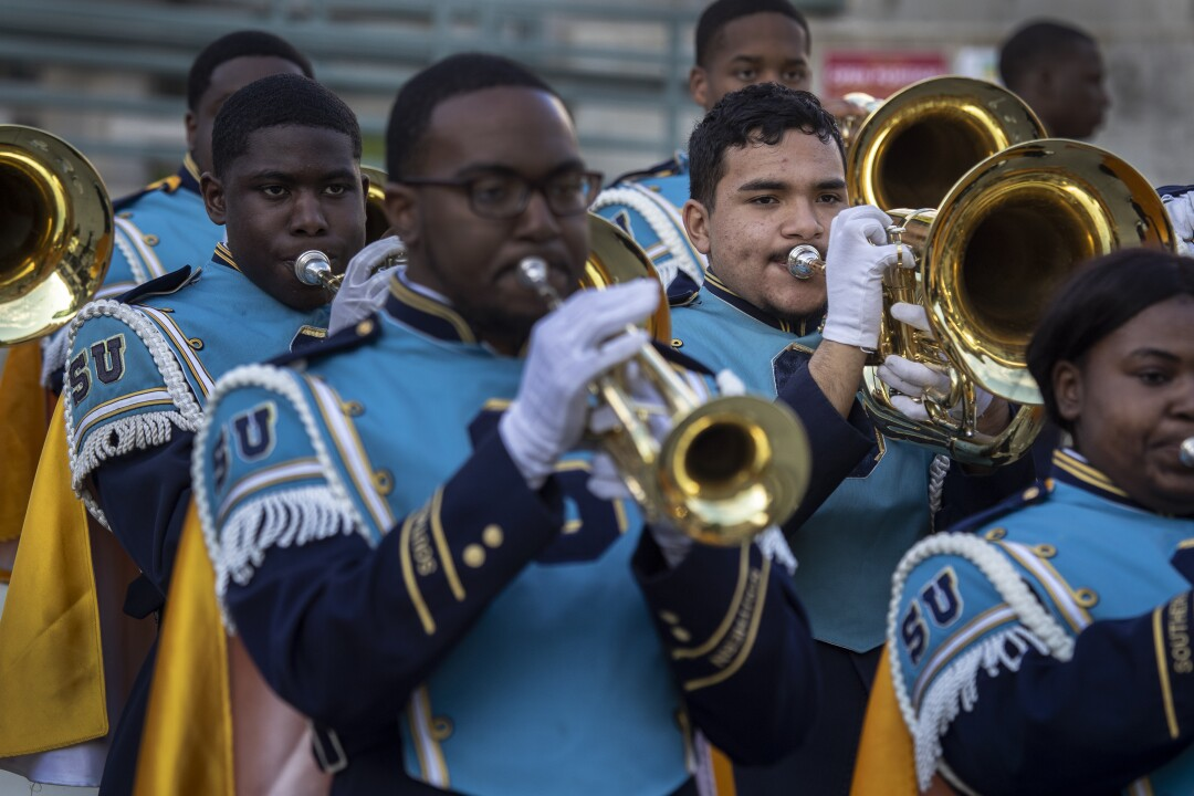 """Zaid Soberanis-Ramos, right, warms up with his 200-plus member squad, the Southern University marching band, a.k.a. the """"Human Jukebox,"""" at Pasadena City College."""