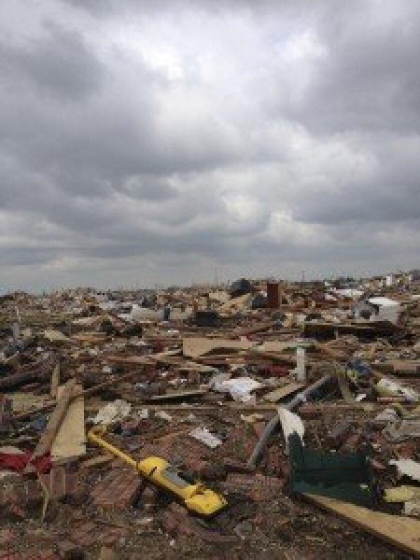 Some of the vast destruction in Moore, Okla. as photographed by Gordon and Maureen Dunfee. For two days the La Jolla couple helped tornado victims sort through the debris.