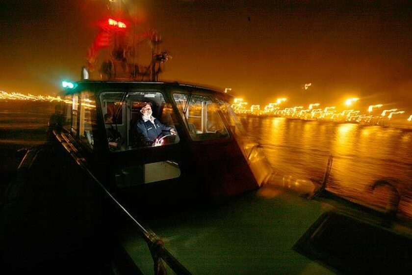 Martin Maher, who takes port pilots to freighters in Los Angeles Harbor, is one of two veteran captains who are taking early retirement.