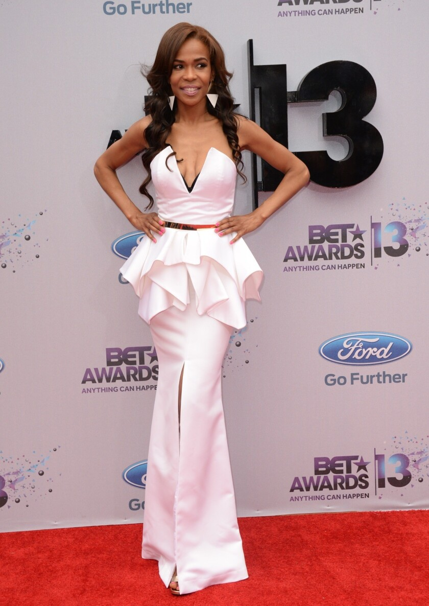 Meagan Good presents BET gospel award in a dress cut to her