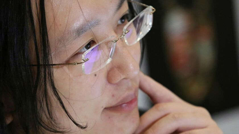 """In this April 12, 2017 photo, Taiwan's """"digital minister"""" Audrey Tang listens to a question during a"""