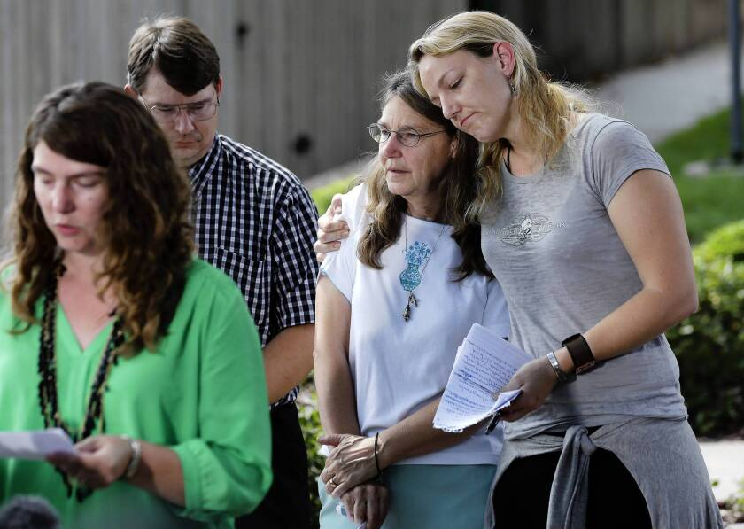 Kerry Cahill, right, comforts her mother, Joleen, as they join other family members to talk about Michael Cahill, who was killed in the 2009 mass shooting at Ft. Hood, Texas. Also pictured are Keely Vanacker and brother James.