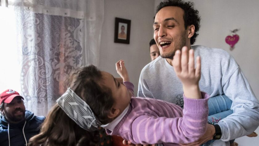 Egyptian photojournalist Mahmoud Abou Zeid, widely known as Shawkan, plays with his niece at his home in Cairo on March 4.