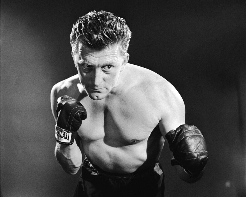 "Kirk Douglas in a promotional photo for the 1949 film ""Champion."""