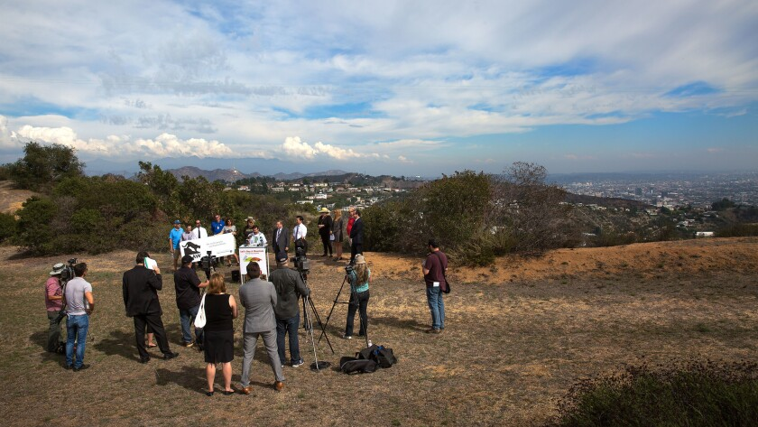 Members of the Laurel Canyon Assn., Citizens for Los Angeles Wildlife and local politicians gather in 2015 on a Laurel Canyon hilltop to announce plans to raise money to buy a 17-acre parcel of the Hollywood Hills.