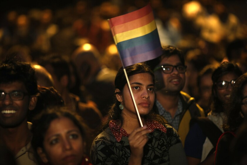 Gay rights activists rally in New Delhi after India's Supreme Court ruled that a colonial-era law criminalizing homosexual sex would remain in effect.
