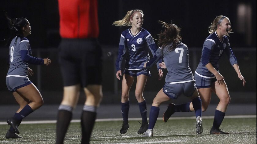 Newport Harbor High's Reese Bodas (3) celebrates her goal with teammates during the first half again