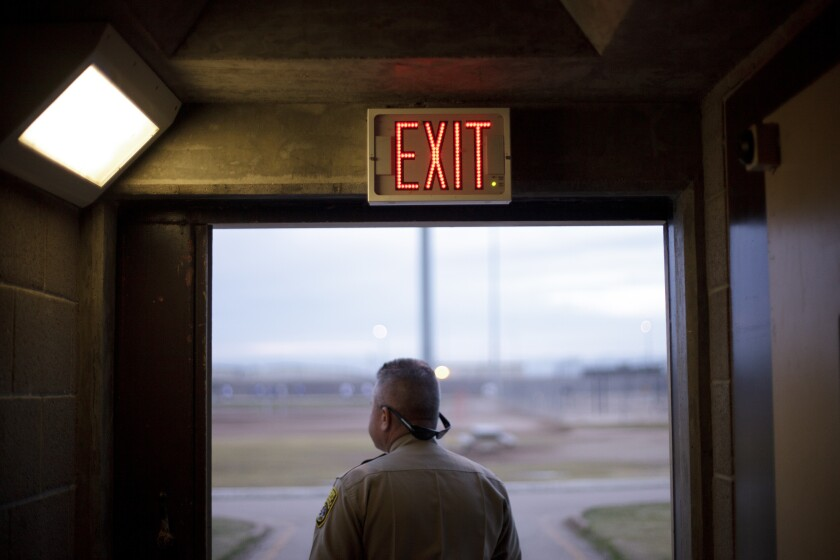 An exit sign is shown in a building of the Calipatria State Prison in Calipatria, California in this 2012 photo.