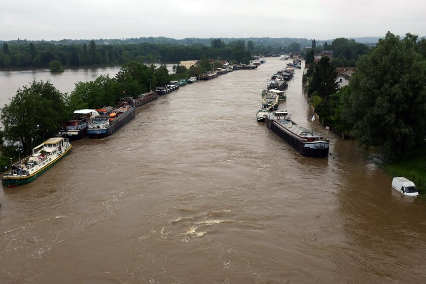 Boats are lined up on the flooded Loing Canal in St Mammes, where the Loing joins the Seine south of Paris, France, Thursday June 2, 2016. Floods inundating parts of France and Germany have left five people dead and thousands trapped in homes or cars, as rivers have broken their banks from Paris to