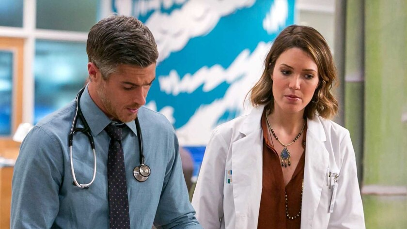 """Dave Annable and Mandy Moore in """"Red Band Society"""" on Fox."""