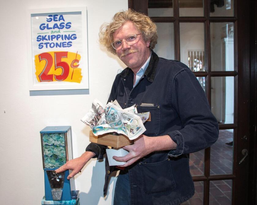 Max Robert Daily with his gumball machine