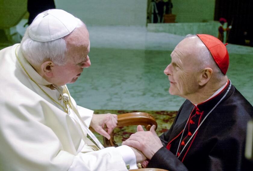 Pope John Paul II shakes hands with Cardinal Theodore McCarrick, archbishop of Washington, in 2001.