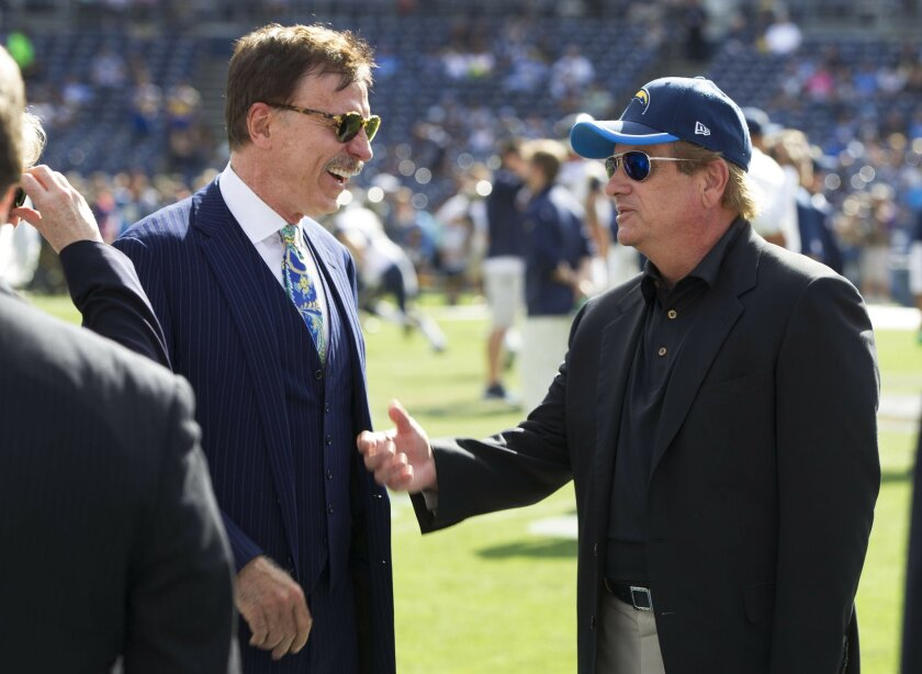 Chargers President Dean Spanos, right, and St. Louis Rams owner Stan Kroenke, shown here prior to their teams' game last season at Qualcomm Stadium, are both working on stadium proposals in Los Angeles.