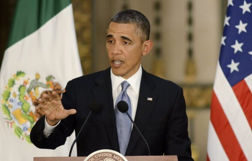 President Obama, talks during a joint news conference with his Mexican counterpart, President Enrique Peña Nieto, in Mexico City on Thursday.