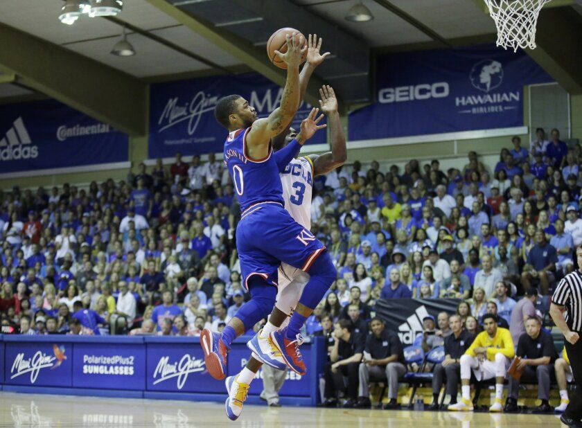 Kansas guard Frank Mason III (0) goes to the basket as UCLA guard Aaron Holiday (3) defends in the first half during an NCAA college basketball game in the second round of the Maui Invitational, Tuesday, Nov. 24, 2015, in Lahaina, Hawaii. (AP Photo/Rick Bowmer)
