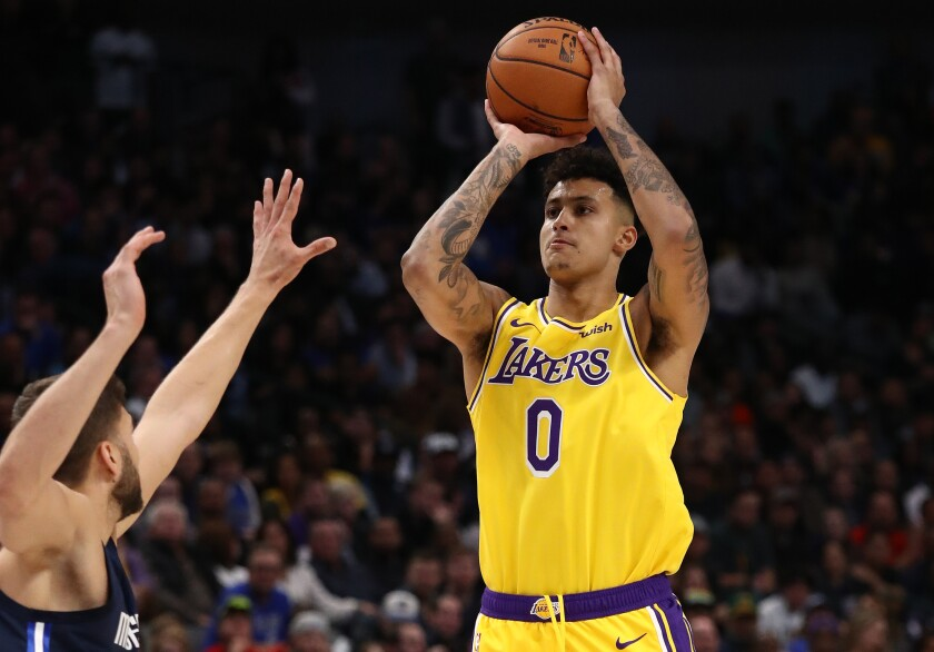 Lakers forward Kyle Kuzma pulls up for a jump shot against the Mavericks during a game Nov. 1, 2019, in Dallas.