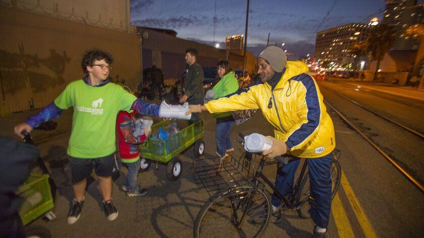 SAN DIEGO, CA 1/11/2019: George Hafner left, a member of Deliverance, San Diego, a homeless outreach