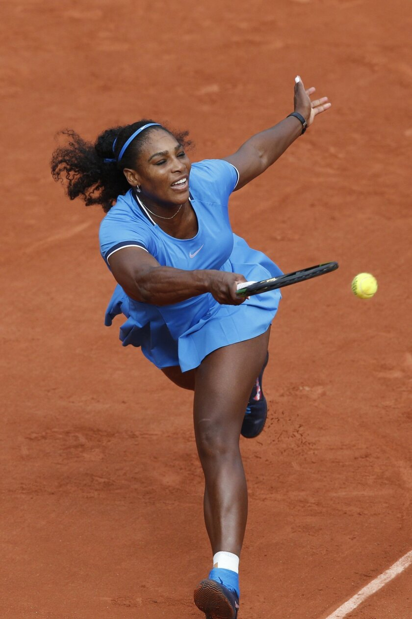 Serena Williams of the U.S. returns in the third round match of the French Open tennis tournament against France's Kristina Mladenovic at the Roland Garros stadium in Paris, France, Saturday, May 28, 2016. (AP Photo/Christophe Ena)