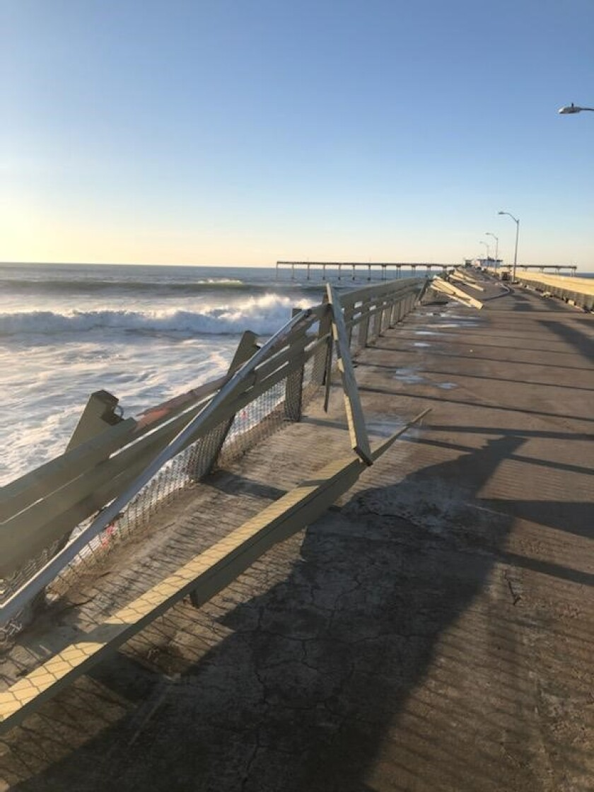 Railing on the south side of the Ocean Beach Pier was damaged by high surf Jan. 11.