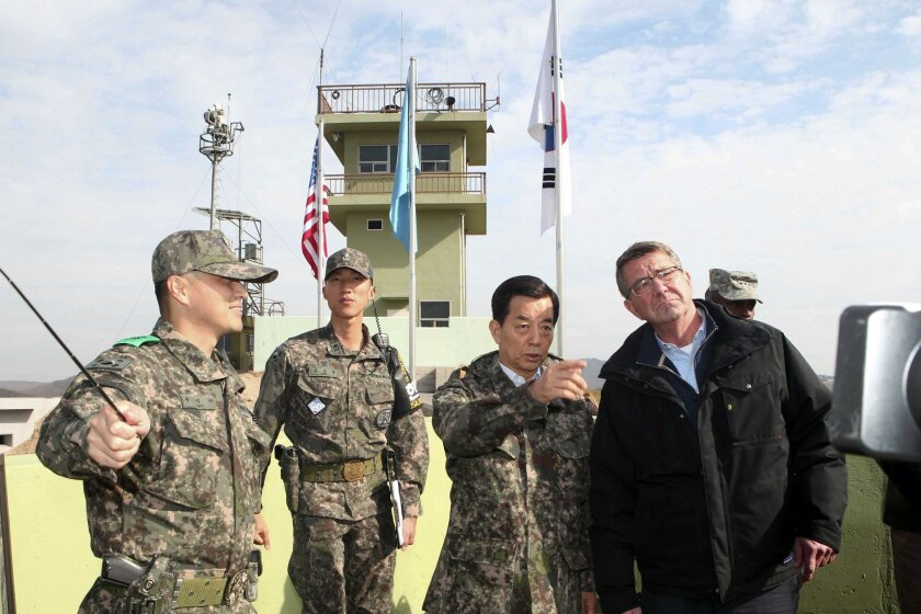 U.S. Defense Secretary Ash Carter, right, and South Korean Defense Minister Han Min Koo, second from right, look towards North Korea at an observation post near the border village of Panmunjom, which has separated the two Koreas since the Korean War, in Paju, South Korea, Sunday, Nov. 1, 2015. Cart