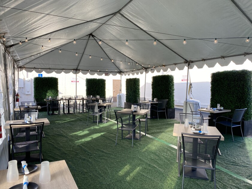 Blade 1936 in Oceanside has built a tented outdoor dining room