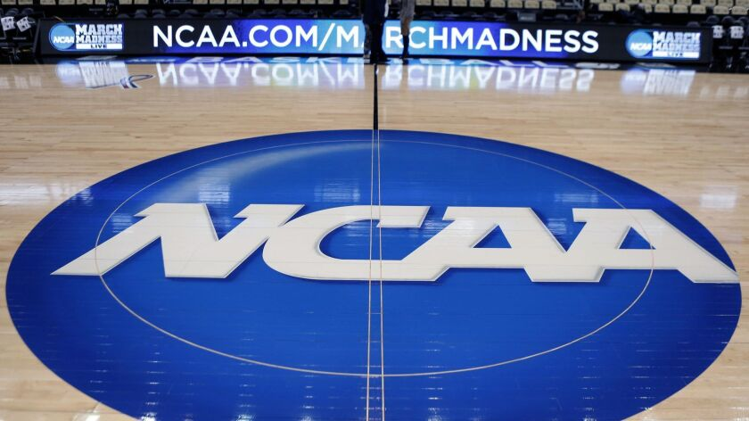 The NCAA logo is displayed at center court as work continues for the NCAA tournament in Pittsburgh on March, 18, 2015.