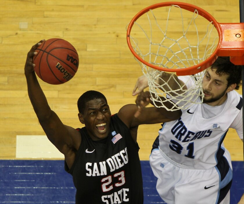 DeShawn Stephens of SDSU takes it to the hoop as John Sinis of USD defends in the first half.