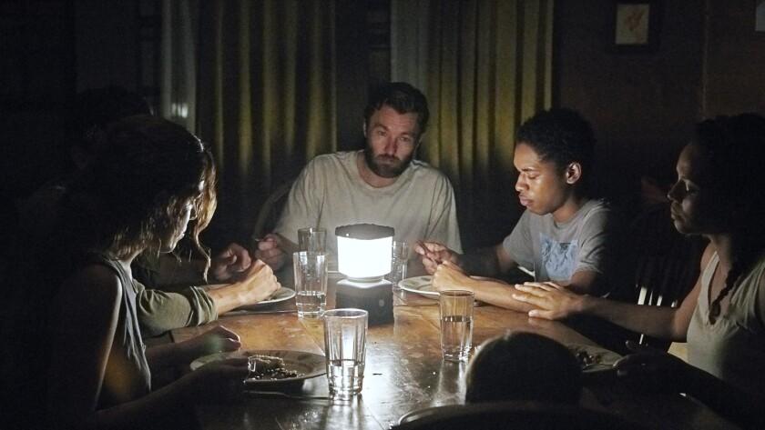 "Riley Keough, left, Christopher Abbott, Joel Edgerton, Kelvin Harrison Jr., Carmen Ejogo and Griffin Robert Faulkner in the movie ""It Comes at Night."""