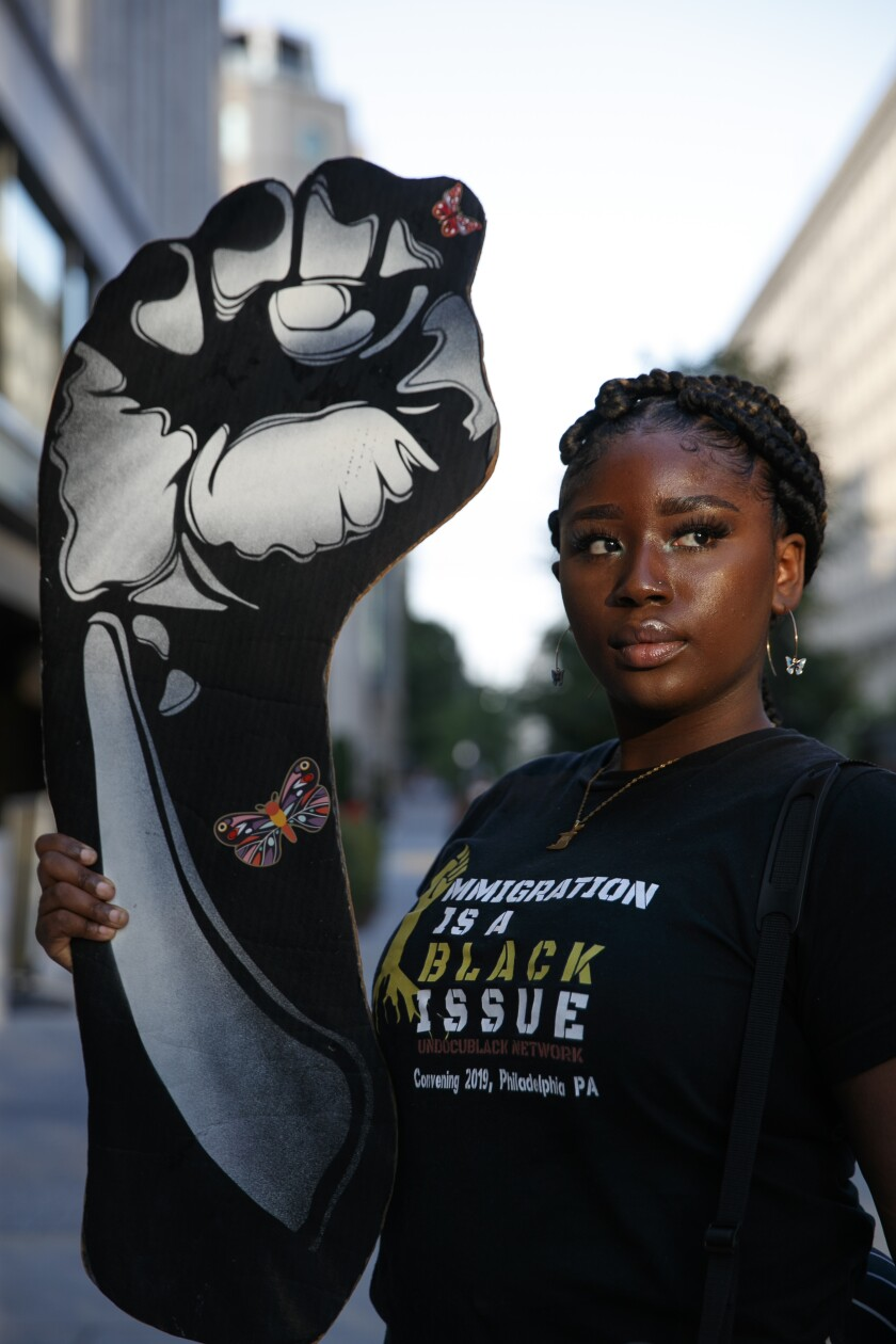 Joella Roberts, 22, of Washington, who is a recipient of the Deferred Action for Childhood Arrivals (DACA) program and is originally from Trinidad and Tobago, poses for a portrait, Friday, June 12, 2020, before leading a protest near the White House in Washington, over the death of George Floyd, a black man who died while in police custody in Minneapolis. Roberts, who founded her own non-profit called Migration Matters, spoke to people visiting the site of protests about immigration and racism. (AP Photo/Jacquelyn Martin)