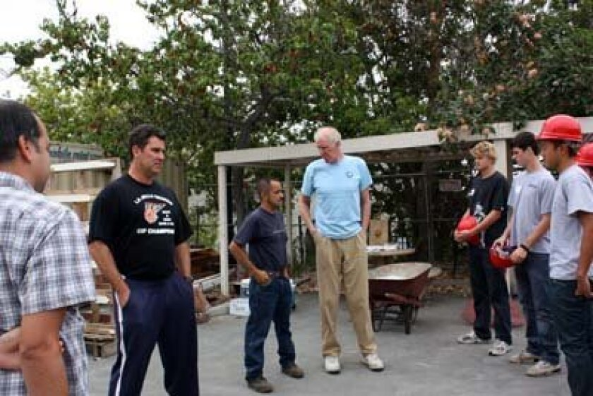 Vikings basketball coach Kamal Assaf, at left, and the players helped Bill Walton, center, work on a landscaping project over the summer at the Challenged Athletes Foundation office. Photo: Kathy Day