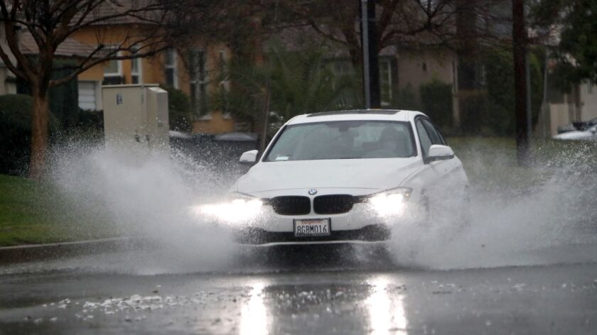 Heavy rain temporarily flooded some streets like on the 2000 block of Bel Aire Dr. in Burbank on Thu