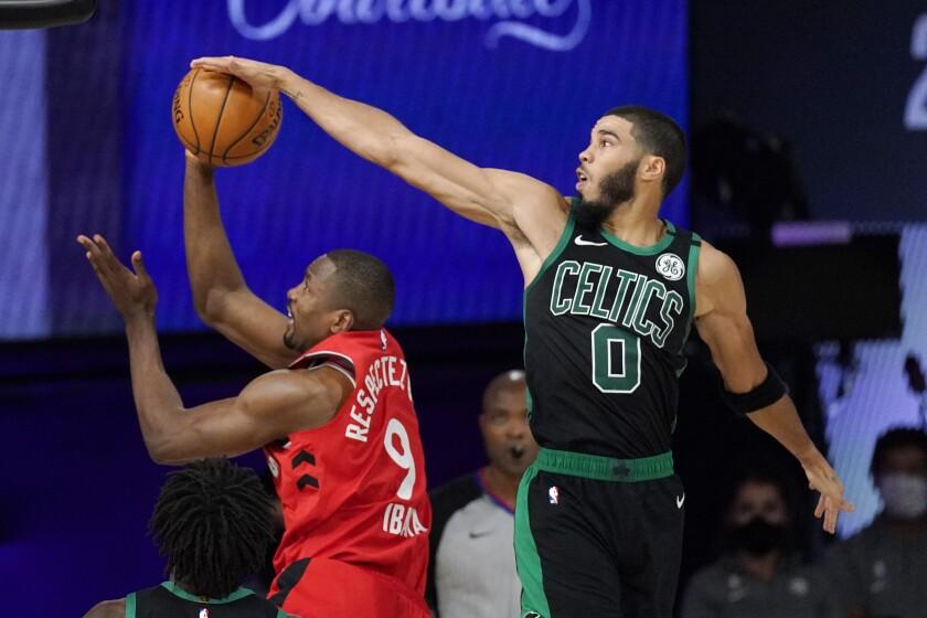 Boston Celtics' Jayson Tatum blocks the shot of Toronto Raptors' Serge Ibaka.