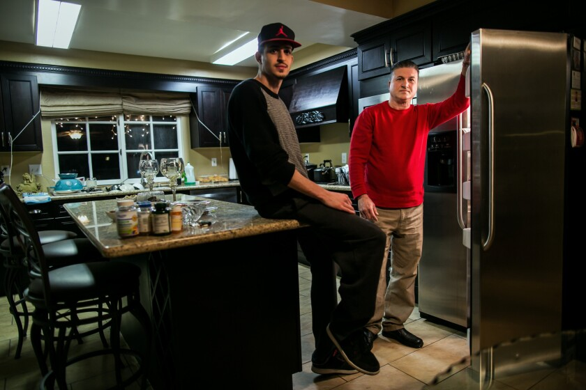 Johnny Pambakian and his son Justin in their newly remodeled kitchen in Porter Ranch.