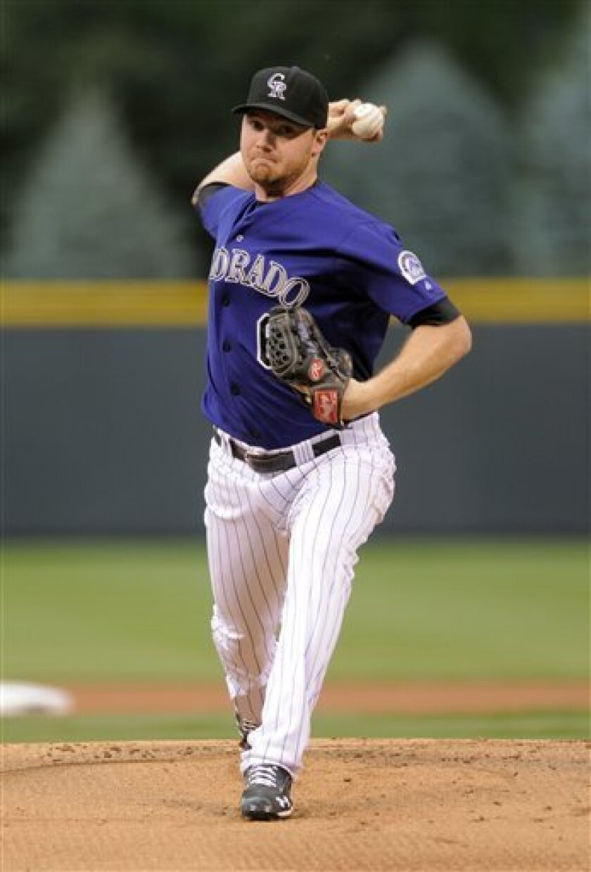 Colorado Rockies starting pitcher Alex White throws against the San Diego Padres during the first inning of a baseball game on Friday, Aug. 31, 2012, in Denver. (AP Photo/Jack Dempsey)