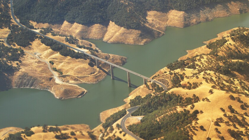 Highway 49 crosses over the New Melones Reservoir in the central Sierra Nevada foothills. On Monday, the reservoir was just 24% full, 40% of its historical average.