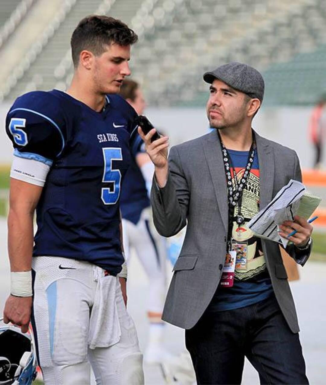 David Carrillo Peñaloza interviewing Corona del Mar High School quarterback Luke Napolitano.