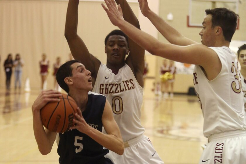 San Marcos' Ben Perez, who scored 11 points, is guarded by Mission Hills' Jean-Luc Williams (0) and Connor Kennedy.