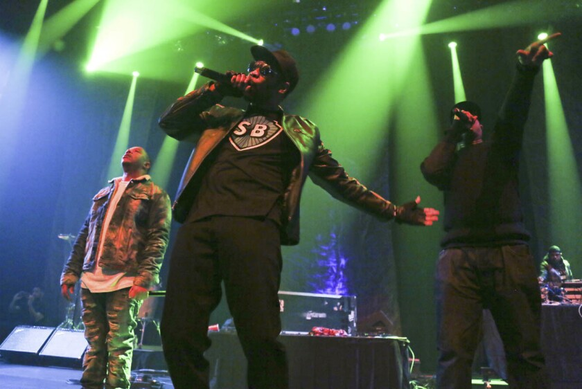 Wu-Tang Clan's U-God, RZA and Masta Killa, from left, perform at the Austin City Limits Live at the Moody Theater during the South by Southwest Music Festival in Austin, Texas. (Jack Plunkett/Invision/AP)