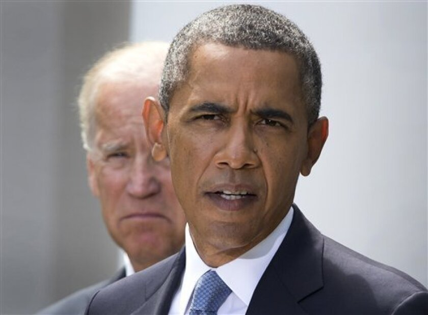 President Barack Obama, flanked by Vice President Joe Biden, talks about the crisis in Syria to media gathered in the Rose Garden of the White House Saturday, Aug. 31, 2013, in Washington. Delaying what had loomed as an imminent strike on Syria for its alleged use of chemical weapons, Obama announc