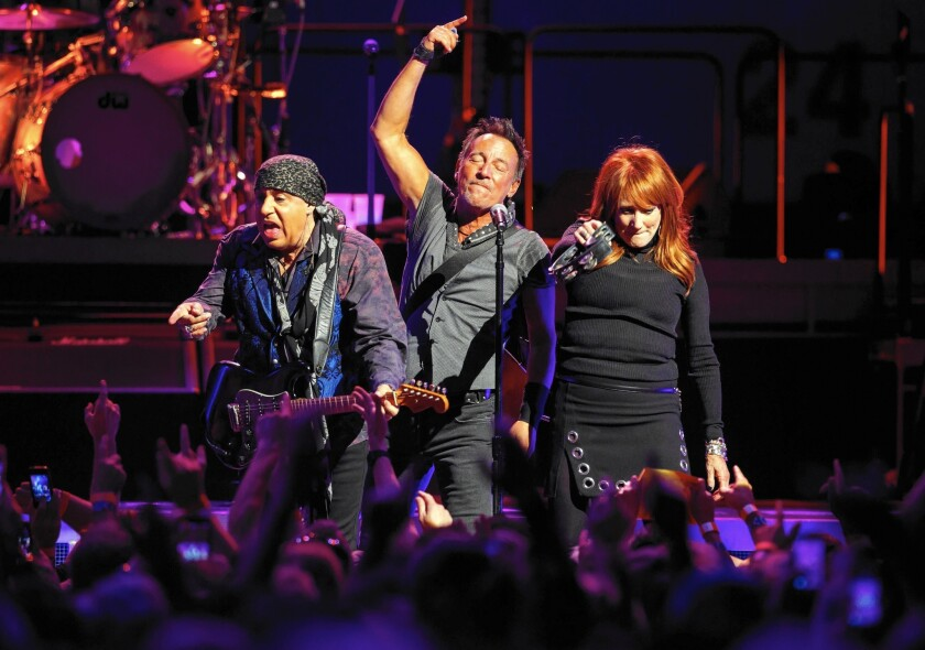 Steven Van Zandt, left, Bruce Springsteen and Patti Scialfa perform at the Los Angeles Sports Arena on March 19, 2016, the last concert at the half-century-old venue in Exposition Park before it's razed to make room for a soccer stadium.