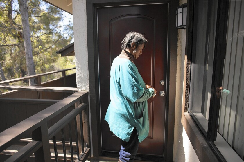 Toni Horn stands at the door of her one-bedroom, one-bath apartment in Lake Forest. Part of her Social Security check will cover the $260 monthly rent for the apartment, which normally would cost around $1,800.