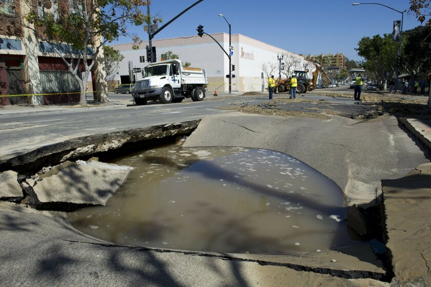 A water main break caused a sinkhole at the intersection of 14th and F streets in the East Village on Wednesday, March 6th, 2013.