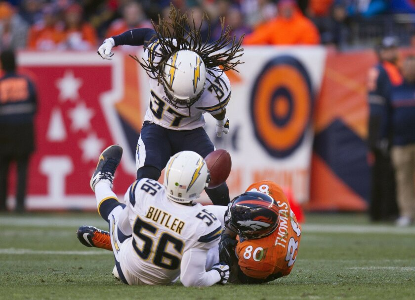 San Diego Chargers vs. The Denver Broncos at Sports Authority Field. Jahleel Addae and Donald Butler force a fumble from Julius Thomas in the first quarter.