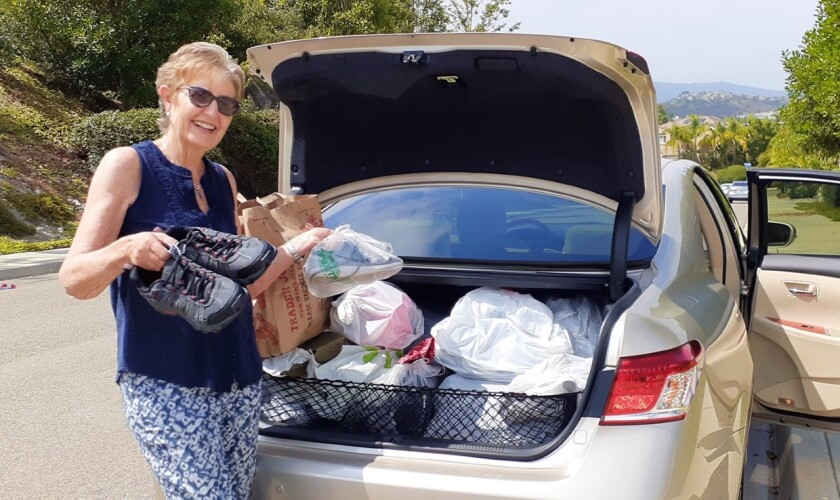 Members of the Contemporary Women of North County, aka CWONC, collected more than 150 shoes
