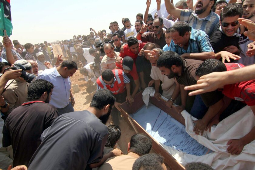 Libyans on Saturday carry the coffin of lawyer and prominent activist Abdel-Salam al-Mesmari, who was shot dead a day earlier, in Benghazi, Libya.