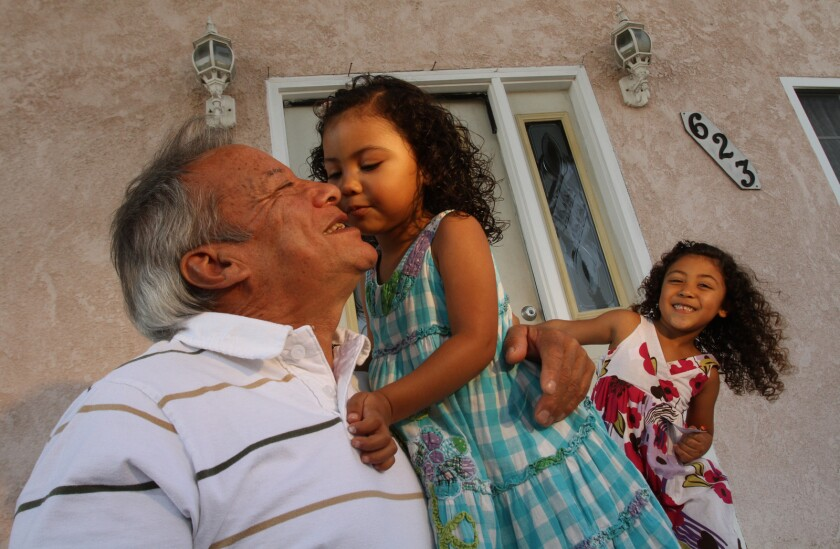 Fidel Lopez, playing with grand daughters Rachael, and Summer, outside his residence in Torrance.