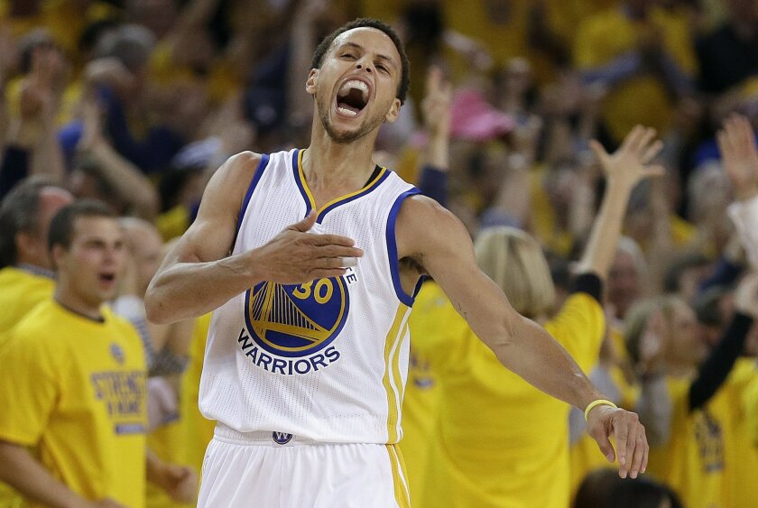 Golden State Warriors guard Stephen Curry (30) reacts after scoring during the first half of Game 5 in a second-round NBA playoff basketball series against the Memphis Grizzlies in Oakland, Calif., Wednesday, May 13, 2015. (AP Photo/Ben Margot)